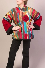 <h5>Tribal Jacket</h5><p>Piecework with silkscreen motifs, asymmetrical closure/button or snaps, side pockets, lined.</p>